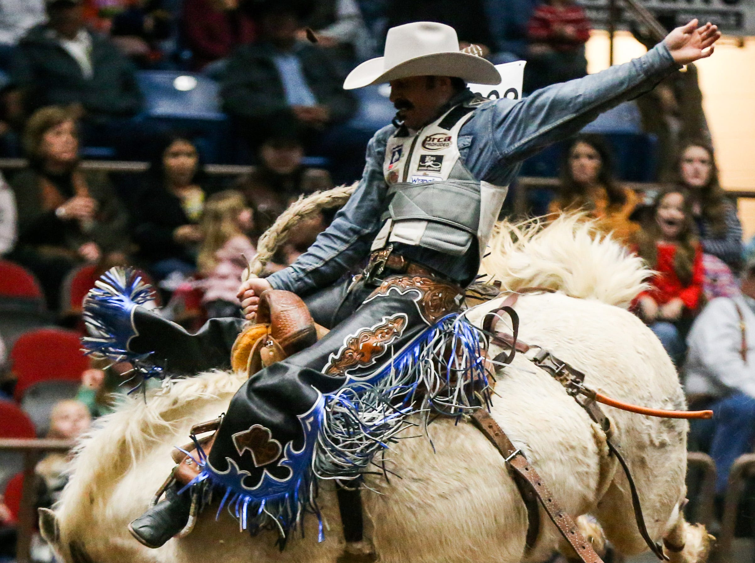 Mitch Pollack rides a bronc during the San Angelo Stock Show & Rodeo matinee show Sunday, Feb. 10, 2019, at Foster Communications Coliseum.