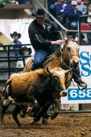 "Sam ""Slammer"" Powers rides out to steer wrestle during the San Angelo Stock Show & Rodeo matinee show Sunday, Feb. 10, 2019, at Foster Communications Coliseum."