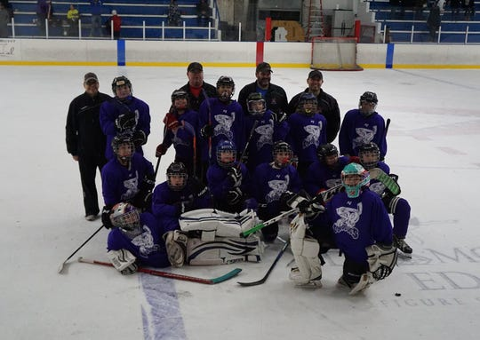 Solan Peterson (bottom left) and his Junior Mudbugs teammate celebrate a second-place finish a tournament in Little Rock, Arkansas, last month
