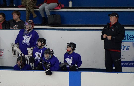 Goaltender Solan Peterson (left) and coach Ronnie Peterson (right, Solan's father) watch on during the Junior Mudbugs' hockey tournament in Little Rock, Arkansas last month.