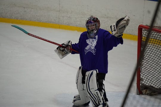The late Solan Peterson plays to the camera during the Junior Mudbugs hockey tournament in Little Rock, Arkansas, in January.