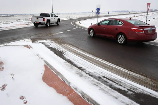 Drivers use the roundabout at Louise Avenue and 271st street Monday, Feb. 11, in Sioux Falls. Some drivers are finding it difficult to adjust to intersections in town governed by roundabouts.