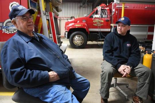 LeRoy Koopman, fire chief for Colton Fire Rescue, and his son Mike Koopman, fire chief for Baltic Fire Rescue, Tuesday, Feb. 5, at the fire station in Colton. LeRoy's sons Mike and Monte Koopman, not pictured, are both firefighters. LeRoy's father was also a firefighter.