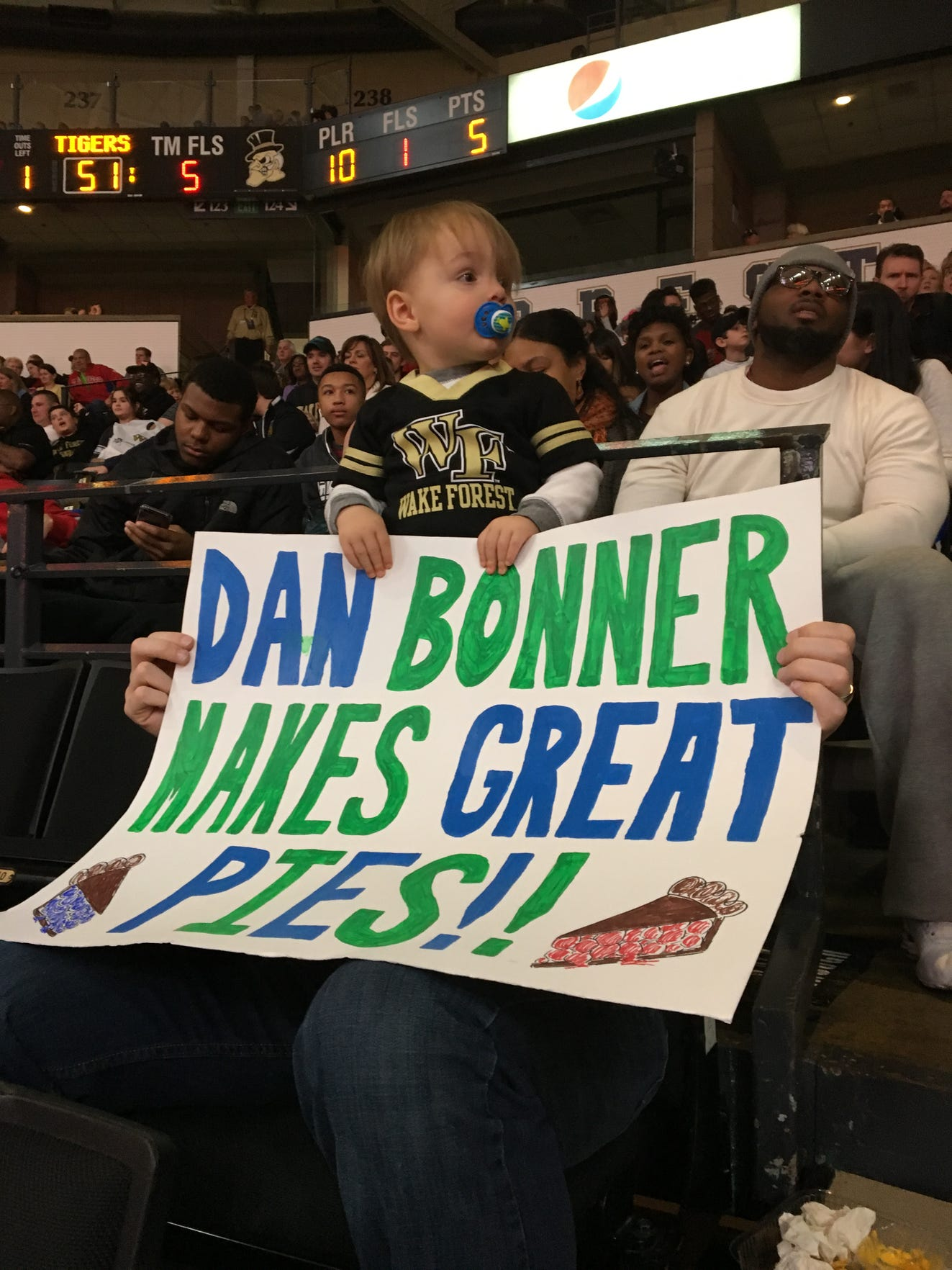 18-month-old Wilder Bryant tells the world about Dan Bonner's pie-making ability during a Wake Forest men's basketball game in 2016.