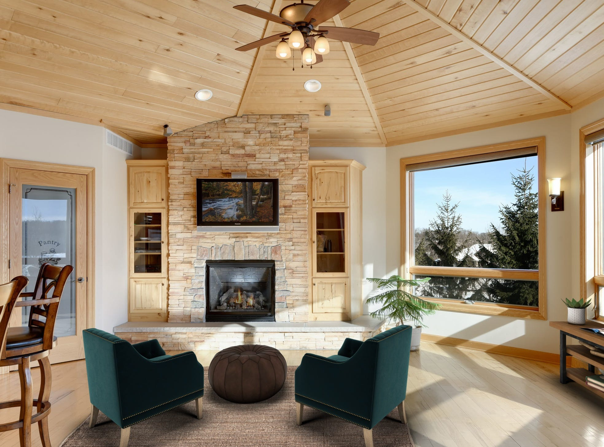 The living room offers a quiet space to relax and entertain and provides access to the large outdoor deck.