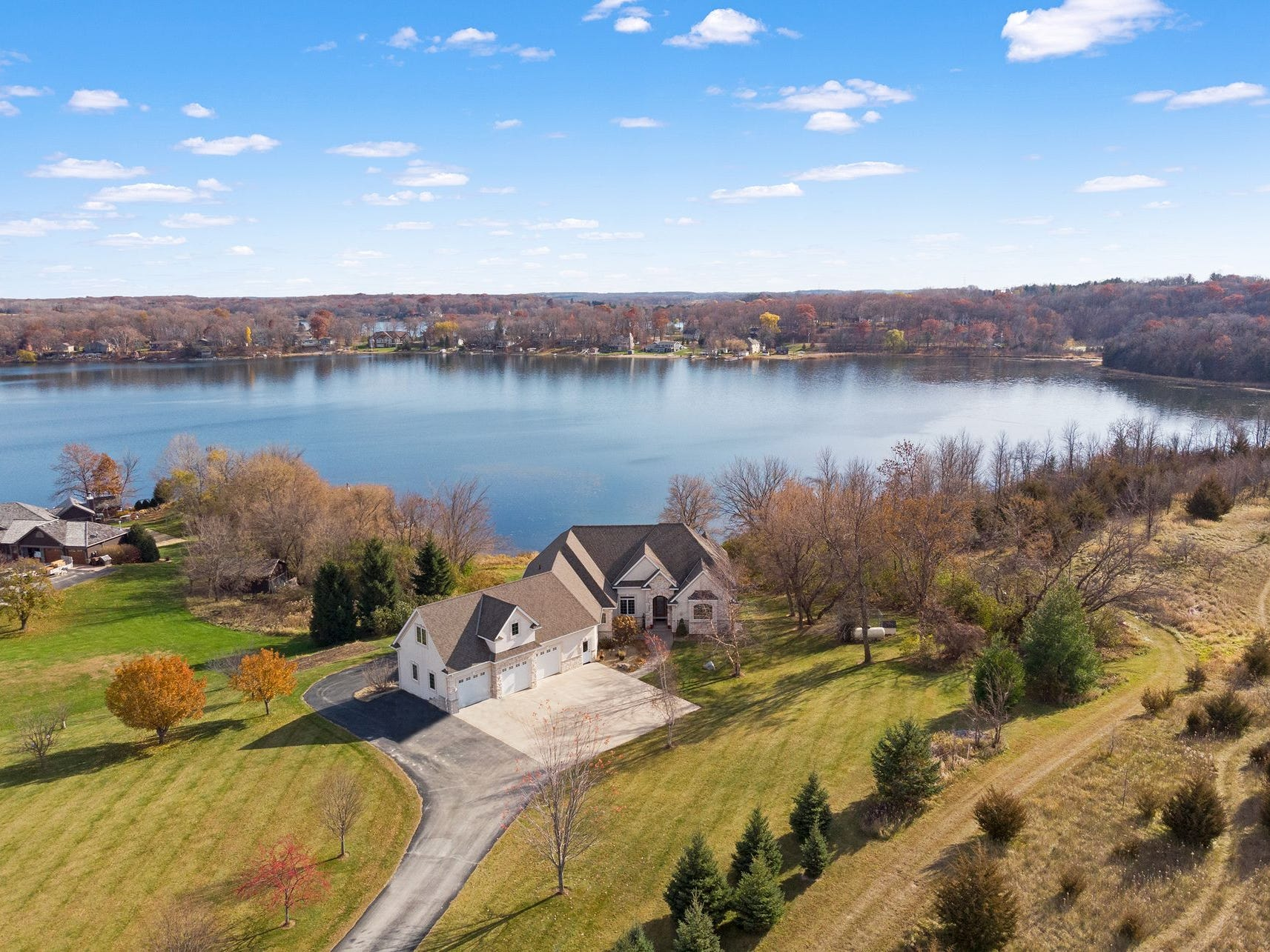 This more than 5,000-square-foot home nestled in an alcove on 150 feet of sandy shoreline on Lake Charlotte offers spaciousness inside and out.