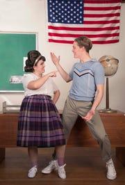 "Tracy Turnblad (Avianna Tato) shows Link Larkin (Aidan Neal) her new moves in ""Hairspray."""