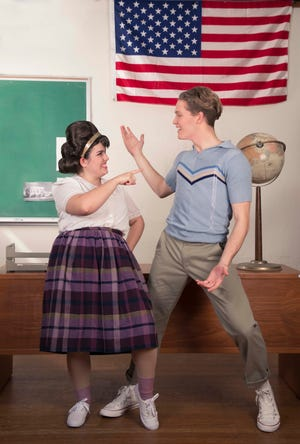 "Tracy Turnblad (Avianna Tato) shows Link Larkin (Aidan Neal) her new moves in ""Hairspray."""