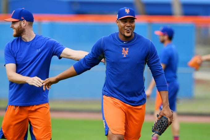 New York Mets teammates Zack Wheeler (left) and Jeurys Familia shakes hands on Monday, Feb. 11, 2019 before the start of an optional practice at First Data Field in Port St. Lucie. The first pitchers and catchers workout will be on Thursday, Feb. 14 followed by the first full squad workout on Feb. 18. The Mets' first spring training game will be held on Feb. 23 against the Atlanta Braves.