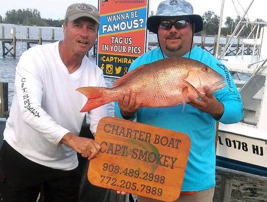 Keith Vieira, right, caught this 20-inch mutton snapper Feb. 3 while fishing on the charter boat Capt. Smokey out of Capt Hiram's Resort in Sebastian.