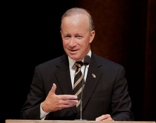 In this Thursday, June 21, 2012 file photo, former Indiana Gov. Mitch Daniels speaks after being named as the next president of Purdue University by the school's trustees in West Lafayette, Indiana.