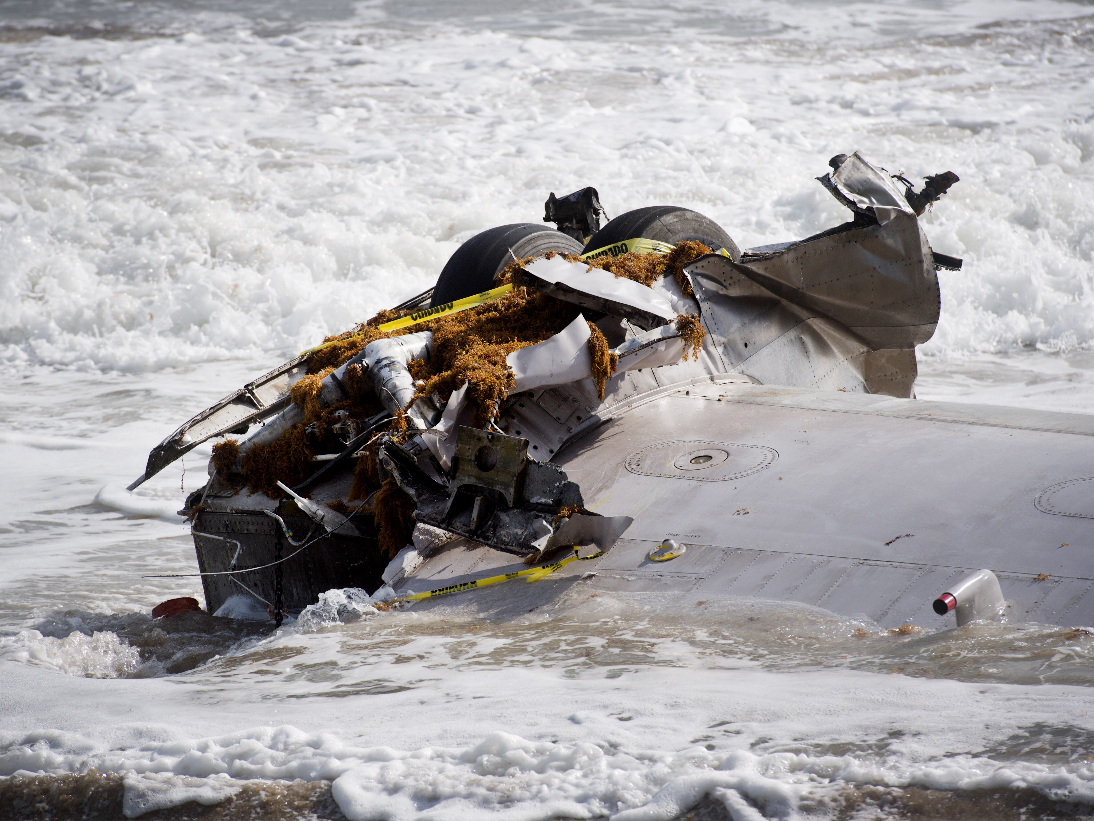 The wing of a plane is seen washing ashore just south of Normandy Beach on Monday, Feb. 11, 2019, in St. Lucie County.