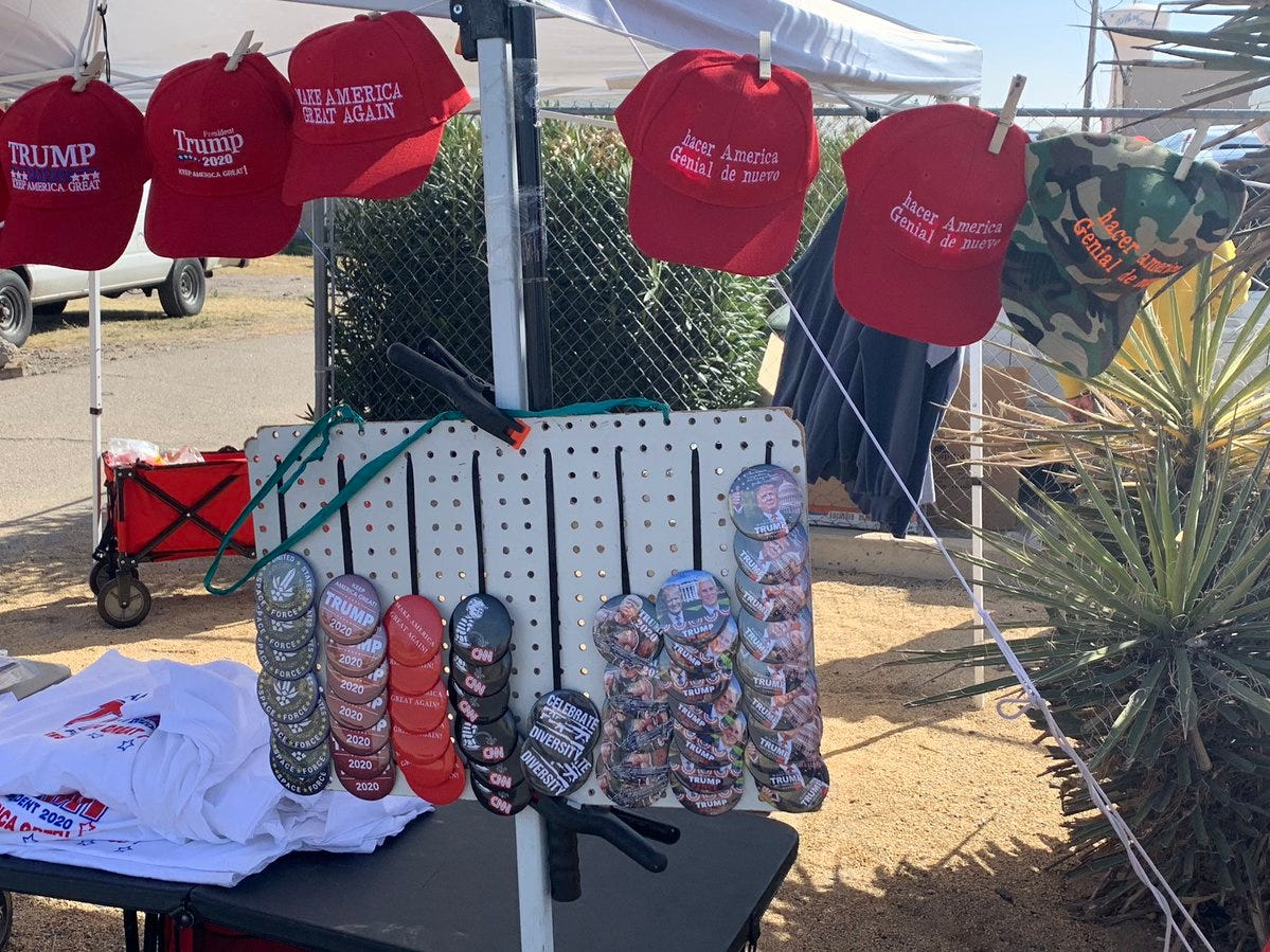 Merchandise in English and Spanish awaits supporters of President Donald Trump on Monday, Feb. 11, 2019, in El Paso.