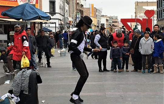 Michael Jackson impersonator Alexis Moreno dances in downtown Juarez, Mexico.
