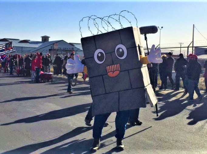 A border wall mascot makes an appearance Monday before President Donald Trump's rally.