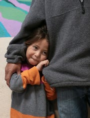 Six-year-old Marilyn snuggles up beside her father at Annunciation House's Casa Vides shelter in Downtown El Paso. The center held a news conference Monday, Feb. 11, 2019, to condemn President Donald Trump's comments about refugees being dangerous.