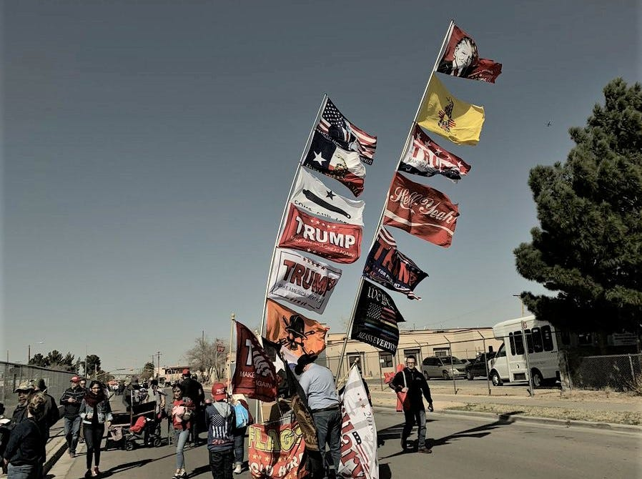 Banners supporting President Donald Trump fly outside the El Paso County Coliseum on Monday, Feb. 11, 2019.