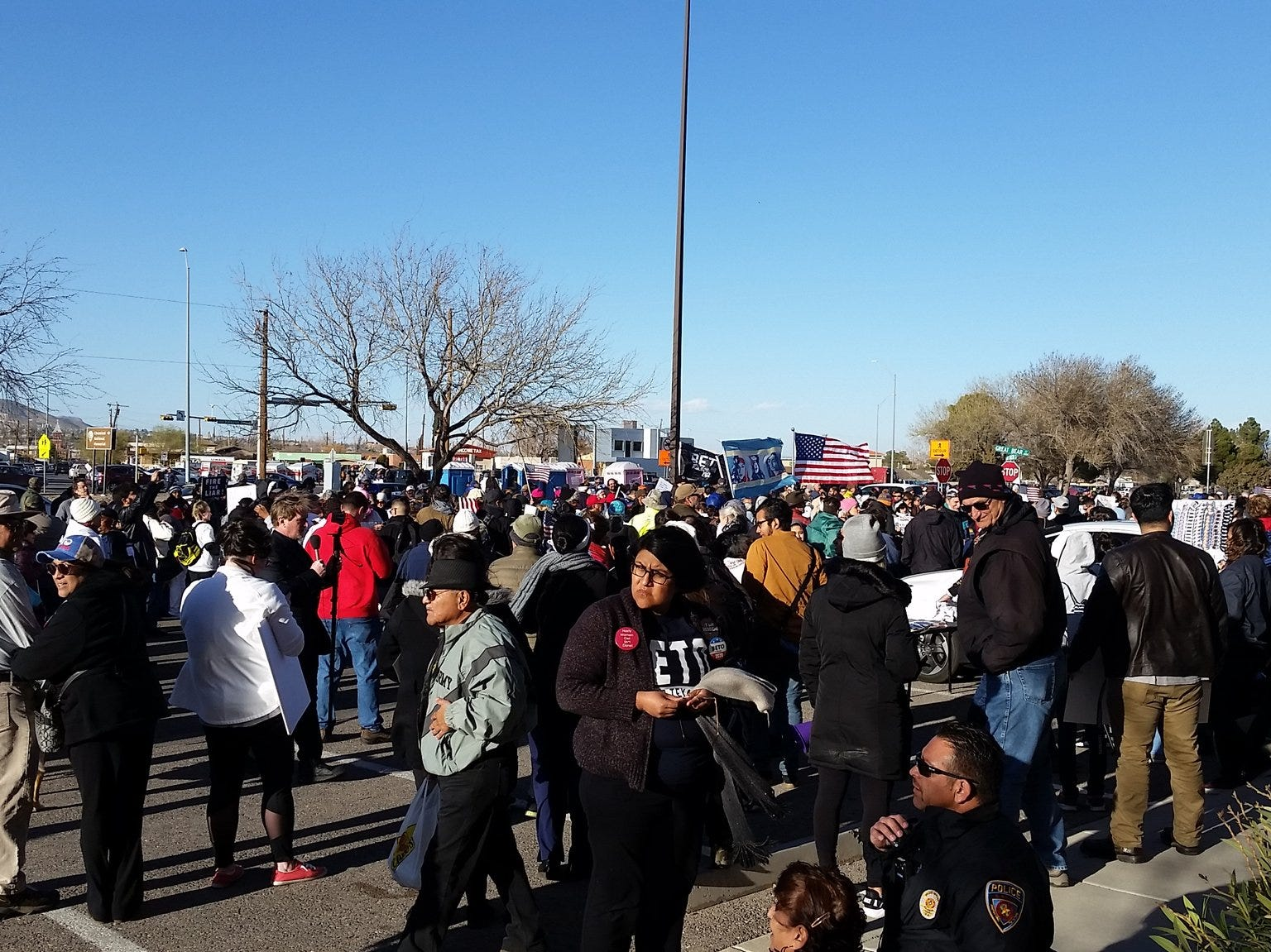The number of counterprotesters grows as they gather Monday.