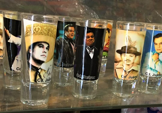 Juan Gabriel and Tin Tan shot glasses are popular sellers at a Mexican artisan shop in Juarez, Mexico.