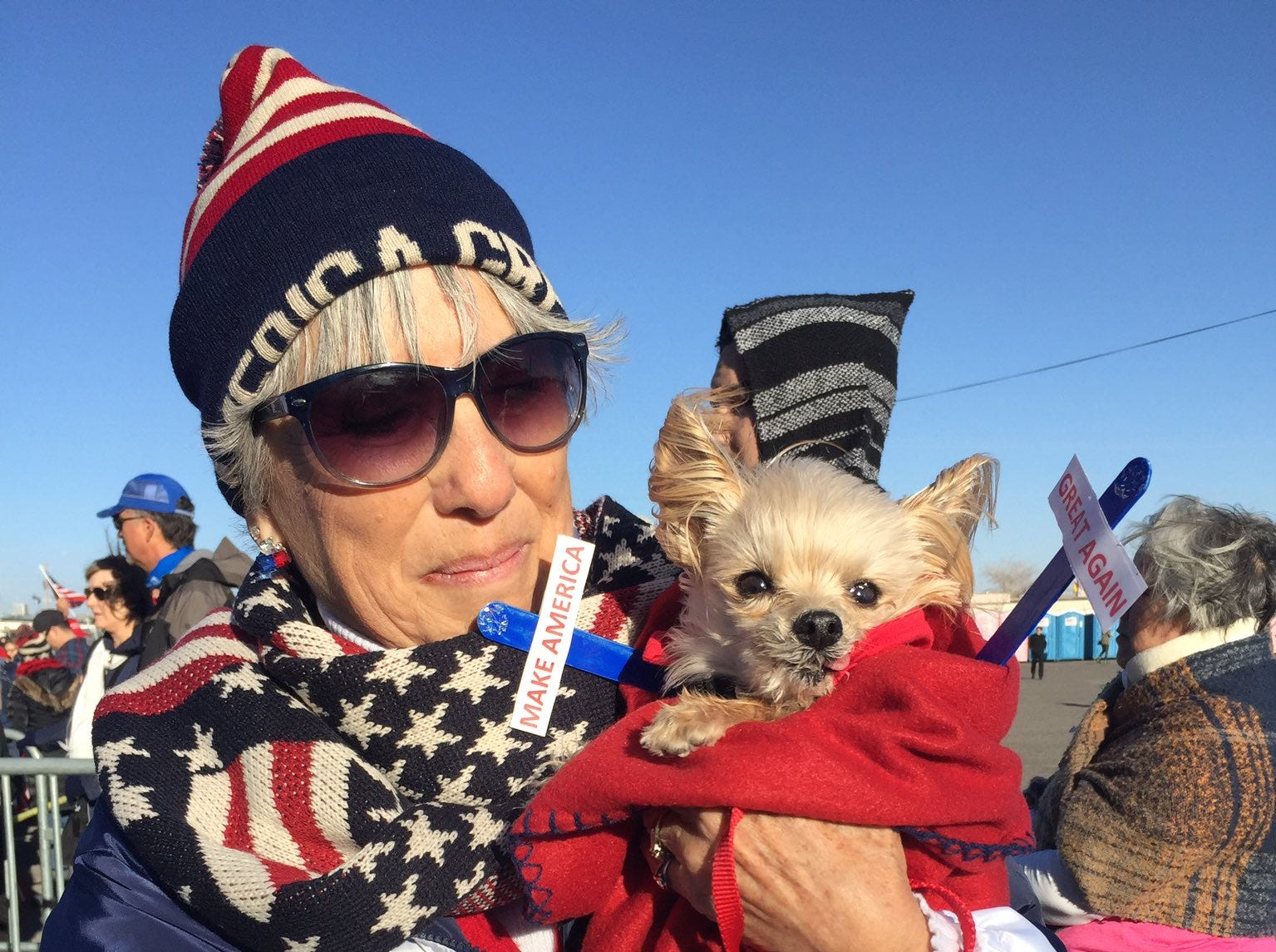 Maria Telles of Las Cruces shows her support for President Donald Trump at before Trump rally in El Paso with her dog, Penny.