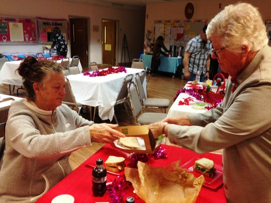 Sylvia Moyer and Barbara Tomblin divvy up food from a lunch box that was donated during a valentine's box social Sunday in Ventura. Buddy Nation, a nonprofit that helps the homeless with pet costs, presented the social at Unitarian Universalist Church. The boxes were auctioned off, with all proceeds benefitting Buddy Nation.