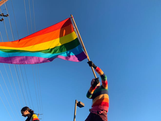 Jake Ayers, a student from Foothill Technology High School in Ventura, waves a rainbow flag Monday outside Thousand Oaks High School. Ayers was one of about a hundred people who gathered in response to demonstrators from Westboro Baptist Church.
