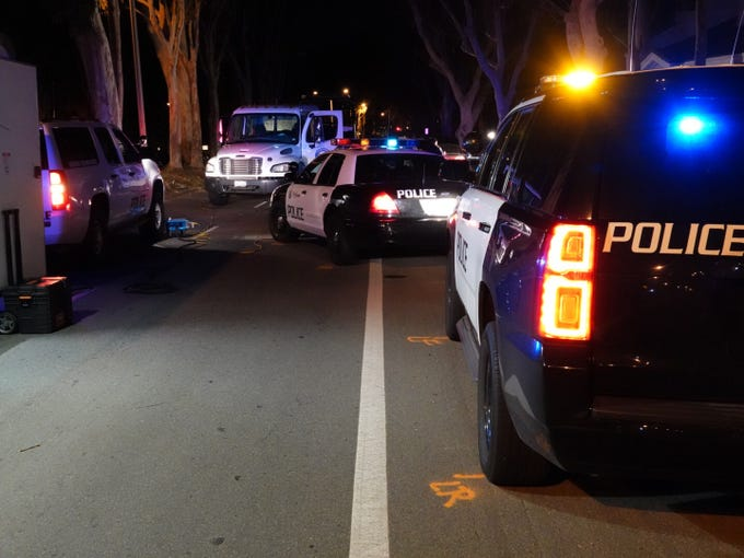 Police cars are marked off on North Ventura Road in Port Hueneme Sunday night after an incident involving a police officer.