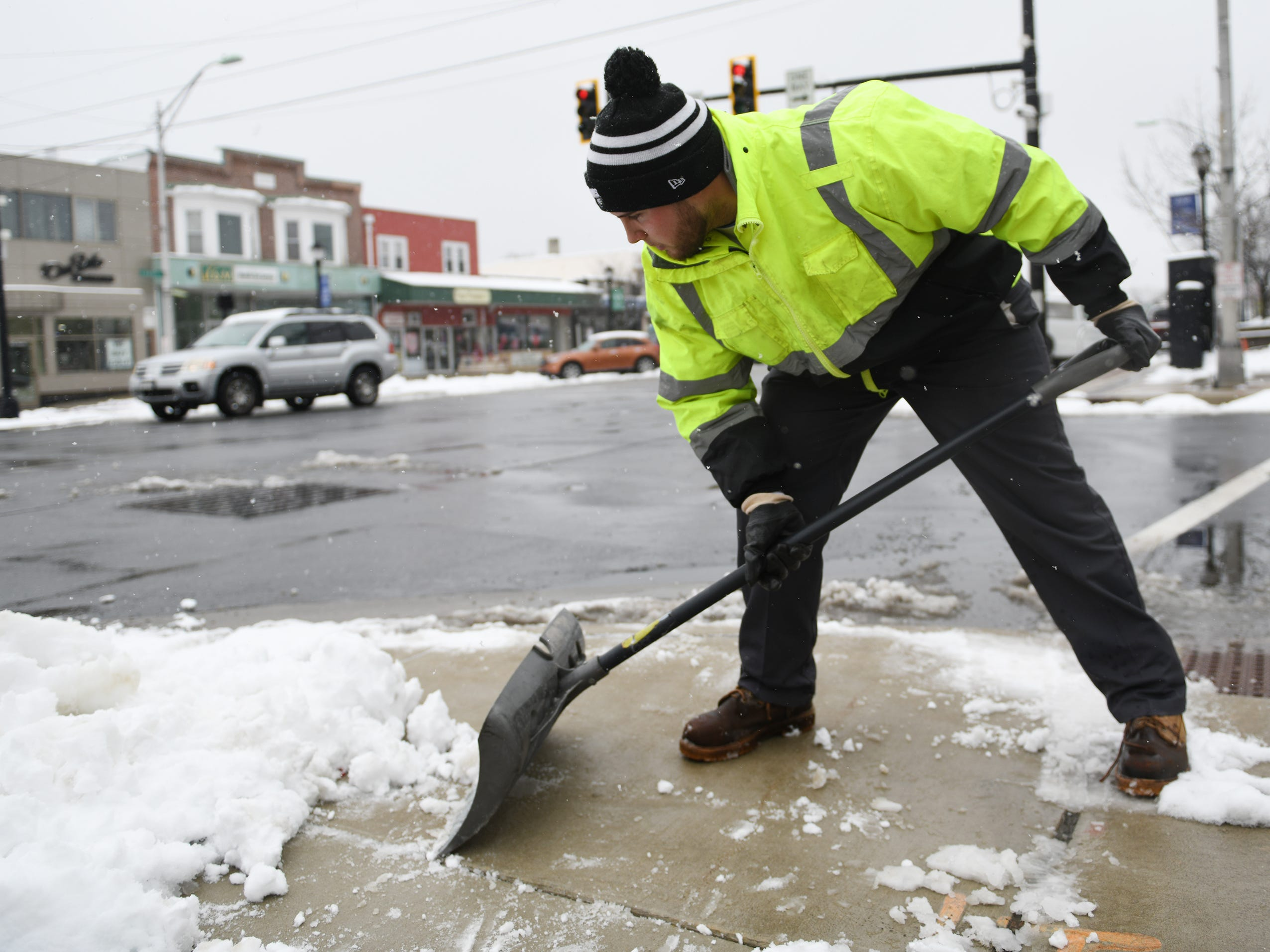 City of Vineland Public Works employee Jeff Valdiseri, 20, shovels snow from crosswalks on Landis Avenue on Monday, Feb. 11, 2019.