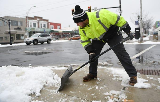 City of Vineland Public Works employee Jeff Valdiseri, 20, shovels snow from crosswalks on Landis Avenue on Monday, Feb. 11, 2019.