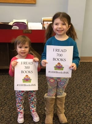 Aurora, 2, and Aria Bertulis, 4, of Millville recently celebrated achieving reading goals. Aurora read 300 books and Aria read 700 books as part of Cumberland County Library's 1000 Books Before Kindergarten Program.  For library information, call (856) 453-2210 or visit www.cclnj.org.