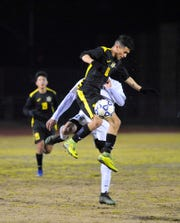 Golden West' Richard Chavez jumps for the ball against El Diamante in the team's regular season finale at Visalia Community Stadium.