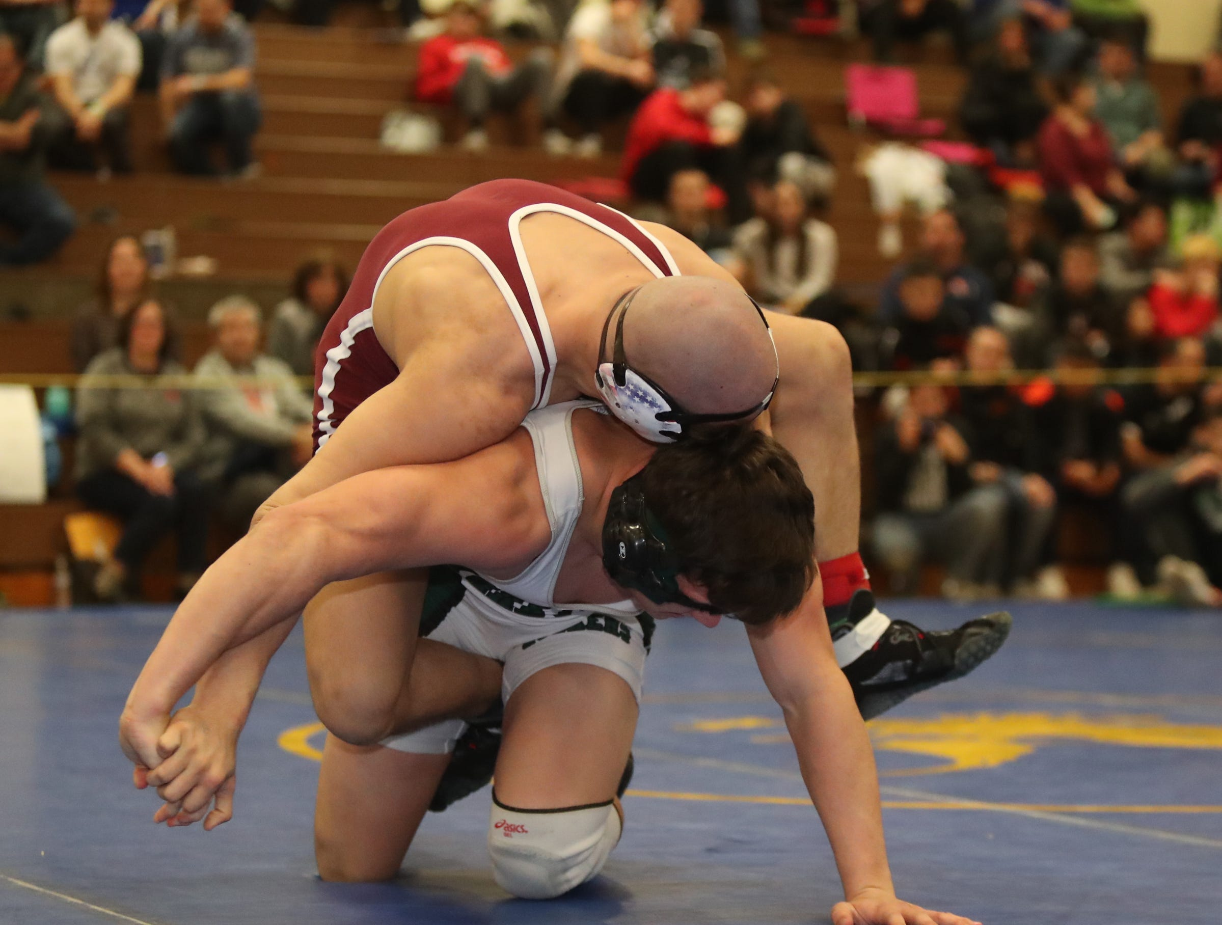 Harrison's Zach Finn defeats Yorktown's Ben Robinson in the 220-pound match of the division I wrestling finals at Clarkstown South High School on Sunday, February 10, 2019.
