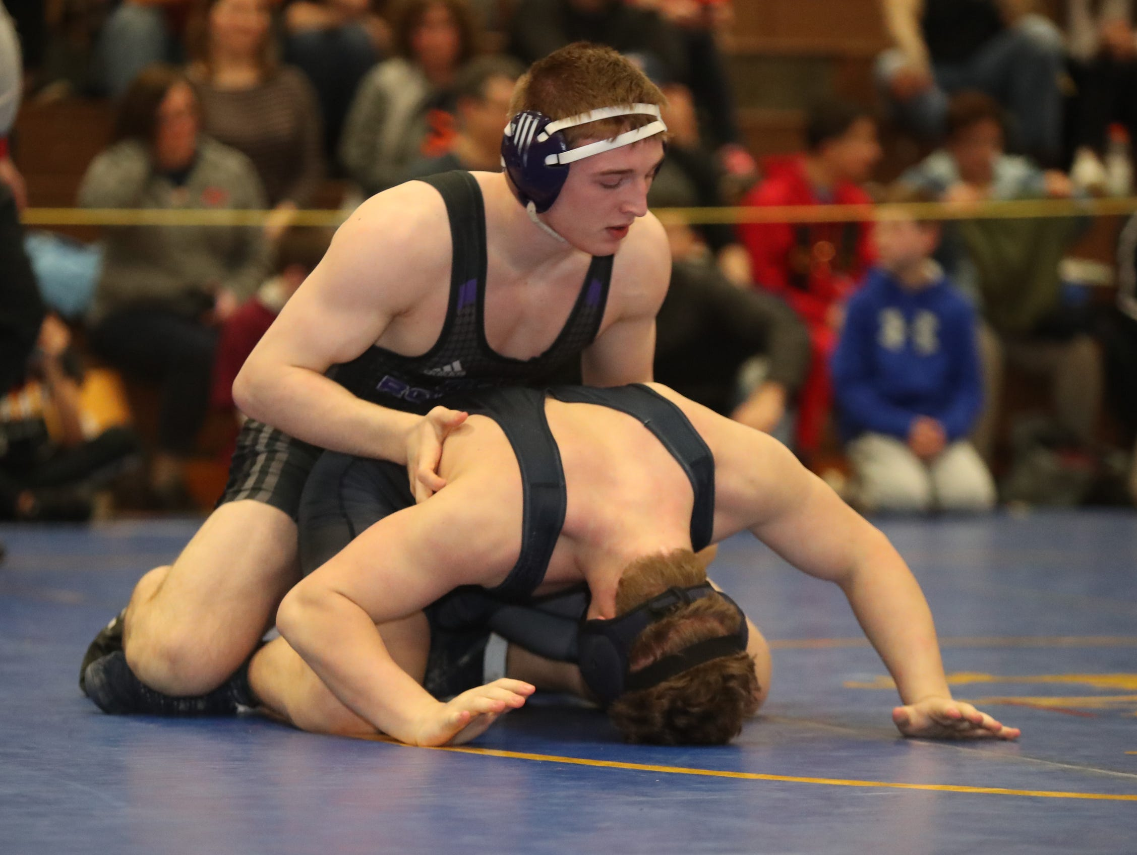 New Rochelle's Jake Logan defeats Byram Hills Alex Behar in the 182-pound match of the division I wrestling finals at Clarkstown South High School on Sunday, February 10, 2019.
