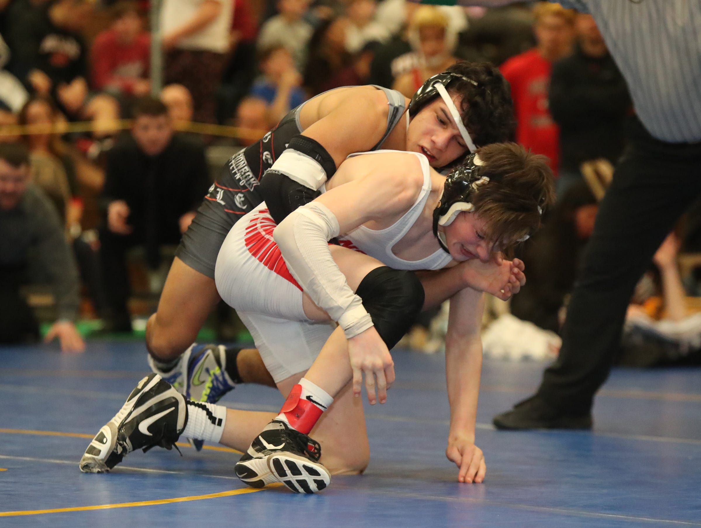 Mamaroneck's Joey Rodas defeats Reece Breyer of North Rockland in the 113-pound match of the division I wrestling finals at Clarkstown South High School on Sunday, February 10, 2019.