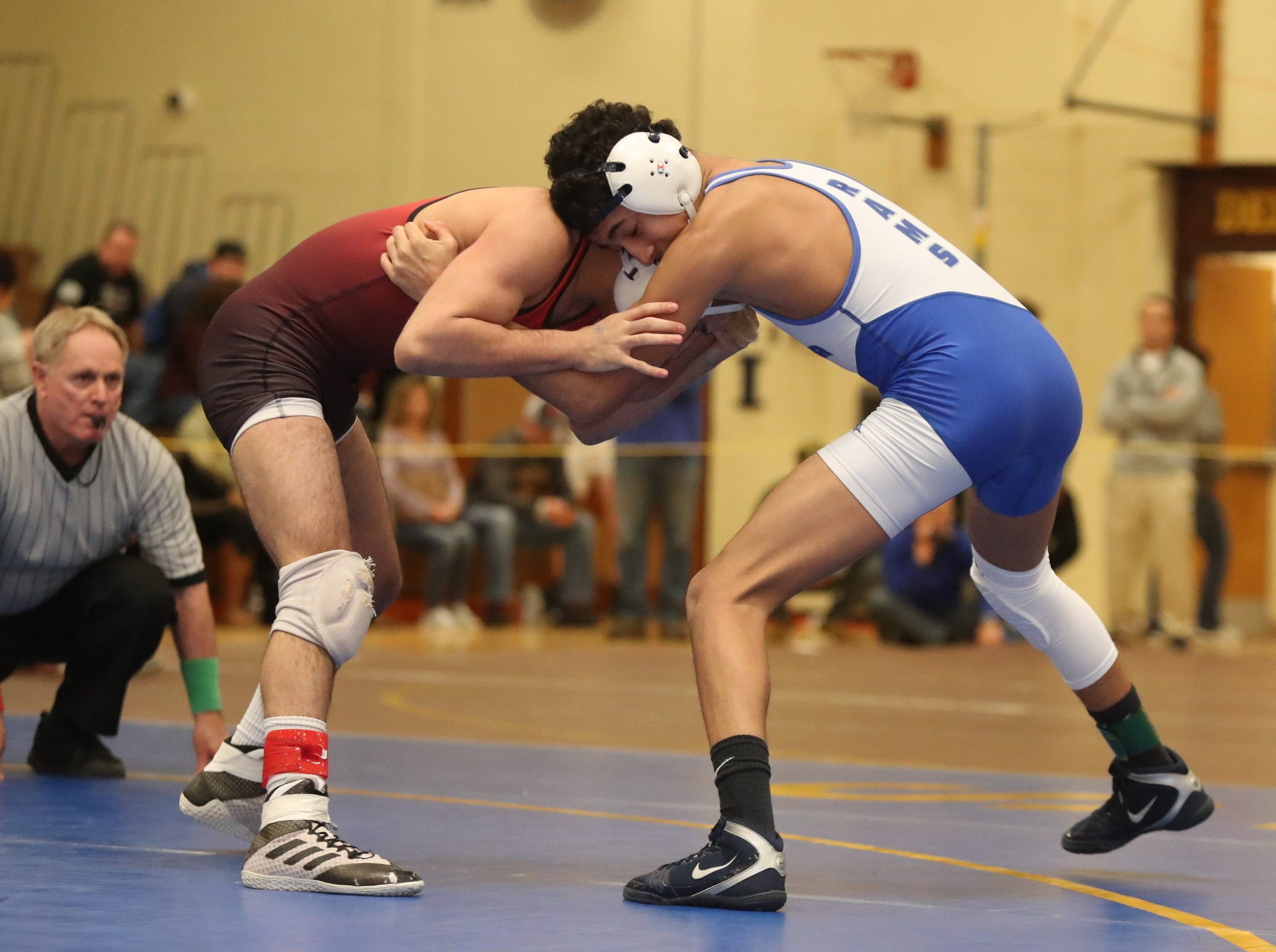 Port Chester's Ivan Garcia defeats Fox Lane's Amos Rivera  in the 120-pound match of the division I wrestling finals at Clarkstown South High School on Sunday, February 10, 2019.
