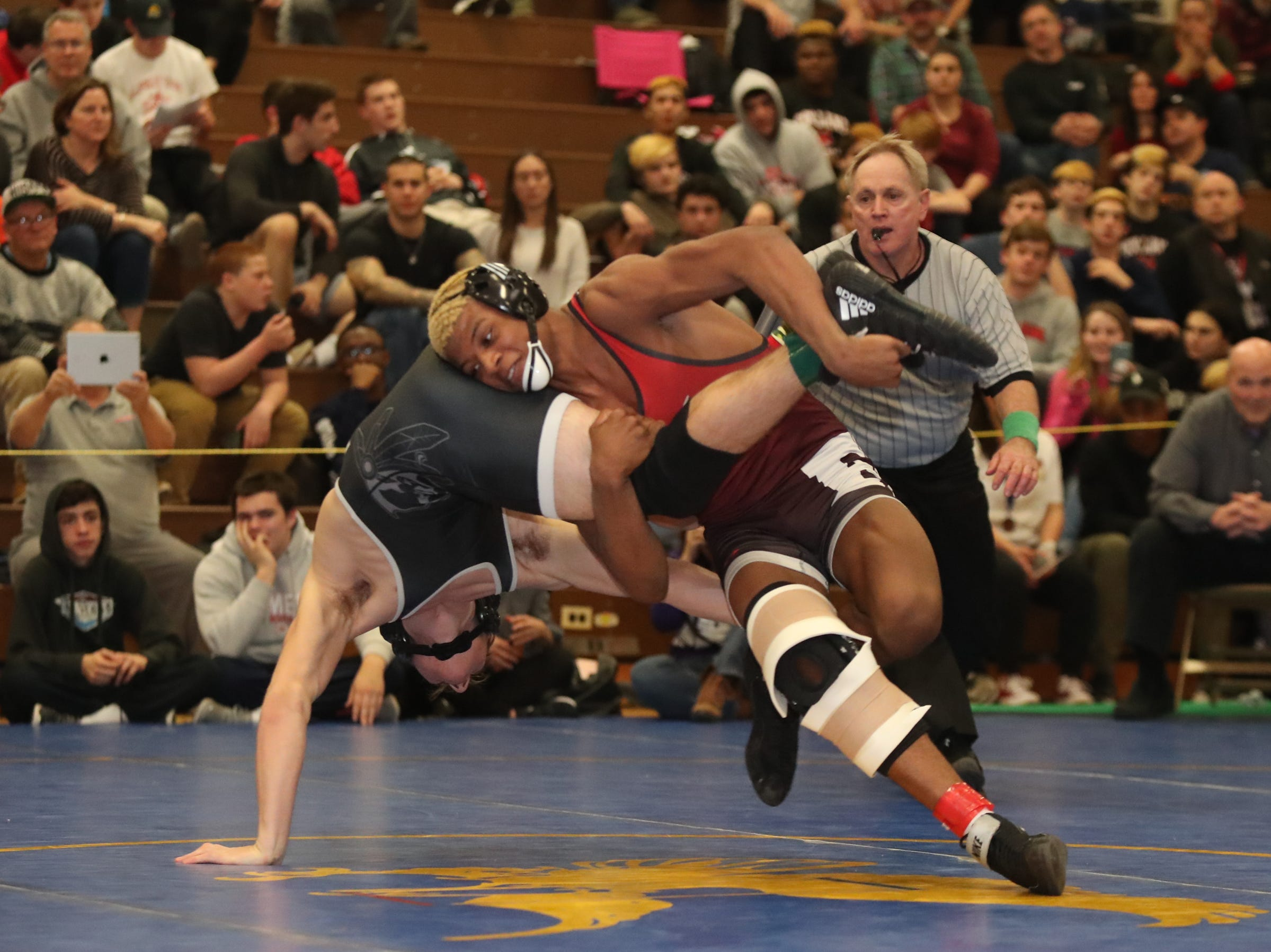Fox Lane's Quincy Downes defeats John Jay-Cross River's Galvin Fiaco in the 160-pound match of the division I wrestling finals at Clarkstown South High School on Sunday, February 10, 2019.
