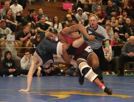 Fox Lane's Quincy Downes defeats John Jay-Cross River's Gavin Fiacco in the 160-pound match of the division I wrestling finals at Clarkstown South High School on Sunday, February 10, 2019.