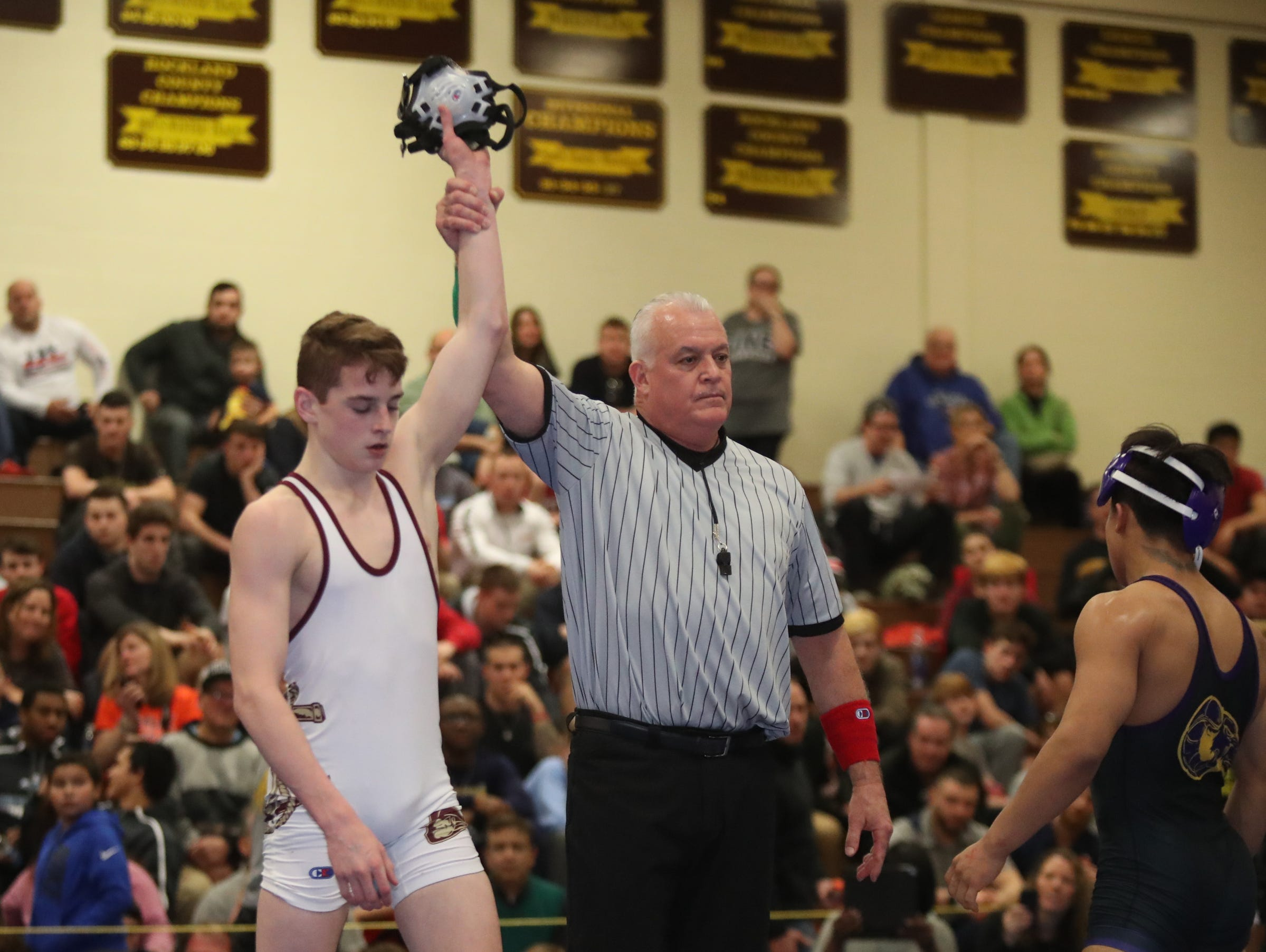 Arlington's Dennis Robin defeats Clarkstown North's Alexis Diaz in the 126-pound match of the division I wrestling finals at Clarkstown South High School on Sunday, February 10, 2019.
