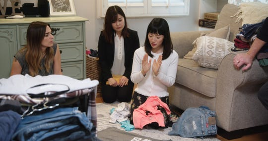 """Rachel Friend, Marie Iida, and Marie Kondo from an episode of the Netflix series """"Tidying Up with Marie Kondo."""""""