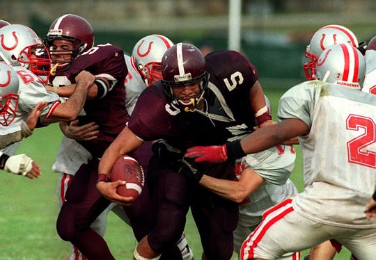 Harrison's Sammy Maldonado makes his way through an opening in the Sleepy Hollow defense during a game at Harrison. Maldonado was a five-star recruit who played college football at Ohio State and Maryland.