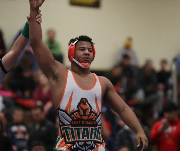 East Ramapo's Jhordyn Innocent defeats White Plains' Sebastian Garibaldi in the 195-pound match of the division I wrestling finals at Clarkstown South High School on Sunday, February 10, 2019.