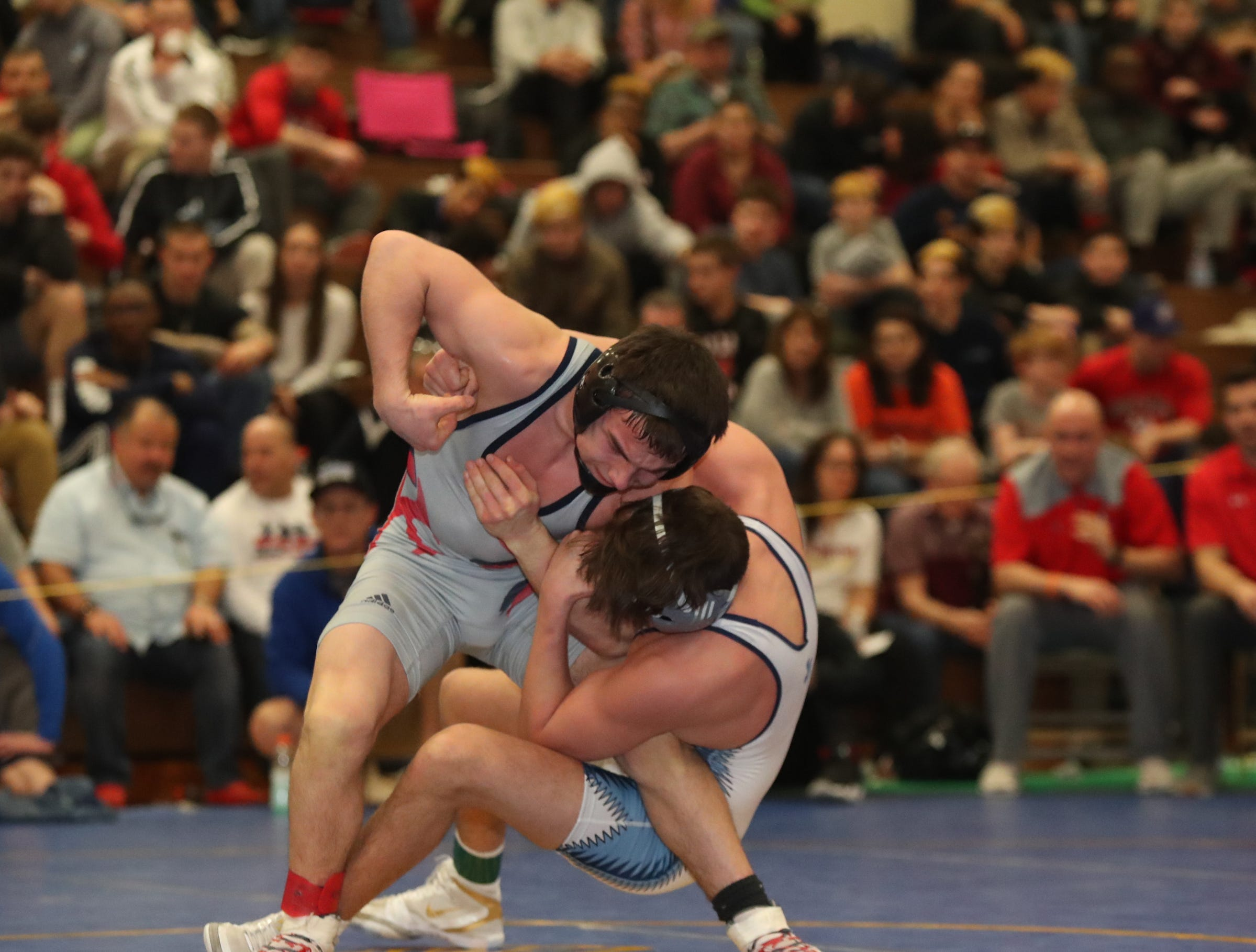 RC Ketcham's Brendan Carroll defeats John Jay-East Fishkill's Tyler Albis in the 138-pound match of the division I wrestling finals at Clarkstown South High School on Sunday, February 10, 2019.