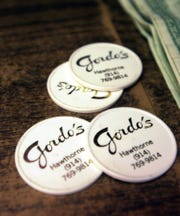 A 2004  file photo of drink coins in Gordo's Bar and Restaurant in Hawthorne. These were used during Happy Hour at Gordon's which just closed after 40 years in business.