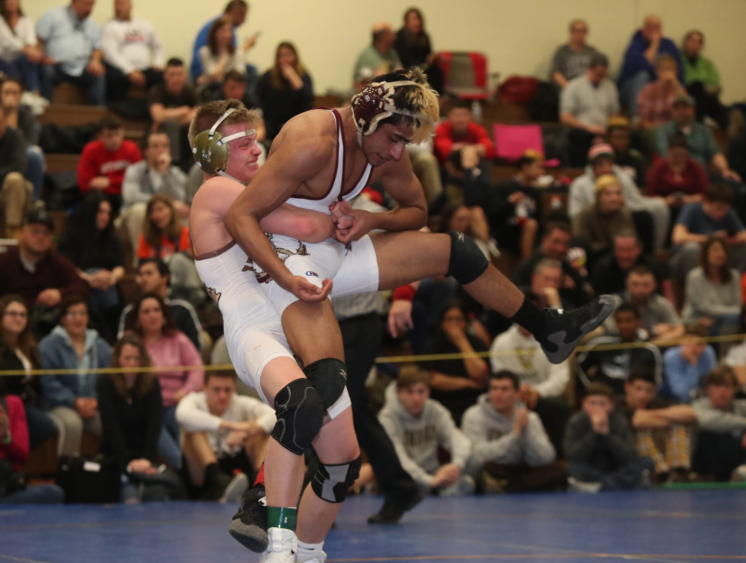 Clarkstown South's James Sullivan defeats Arlington's Firas Zoha in the 132-pound match of the division I wrestling finals at Clarkstown South High School on Sunday, February 10, 2019.