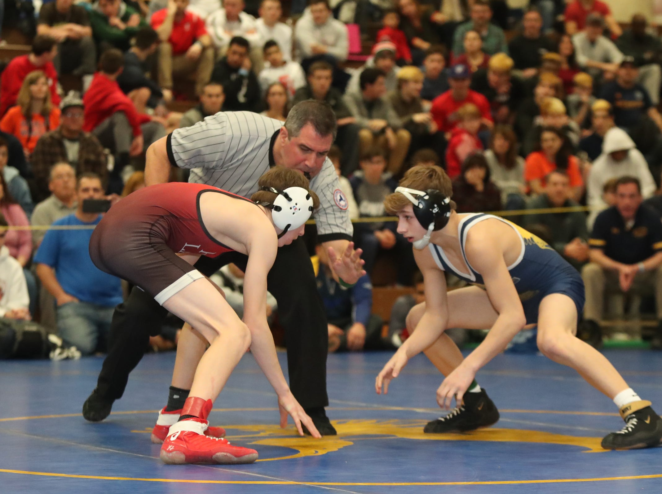 Fox Lane's Jake Hoffman defeats Mahopac's Angelo Centrone in the 99-pound match of the division I wrestling finals at Clarkstown South High School on Sunday, February 10, 2019.