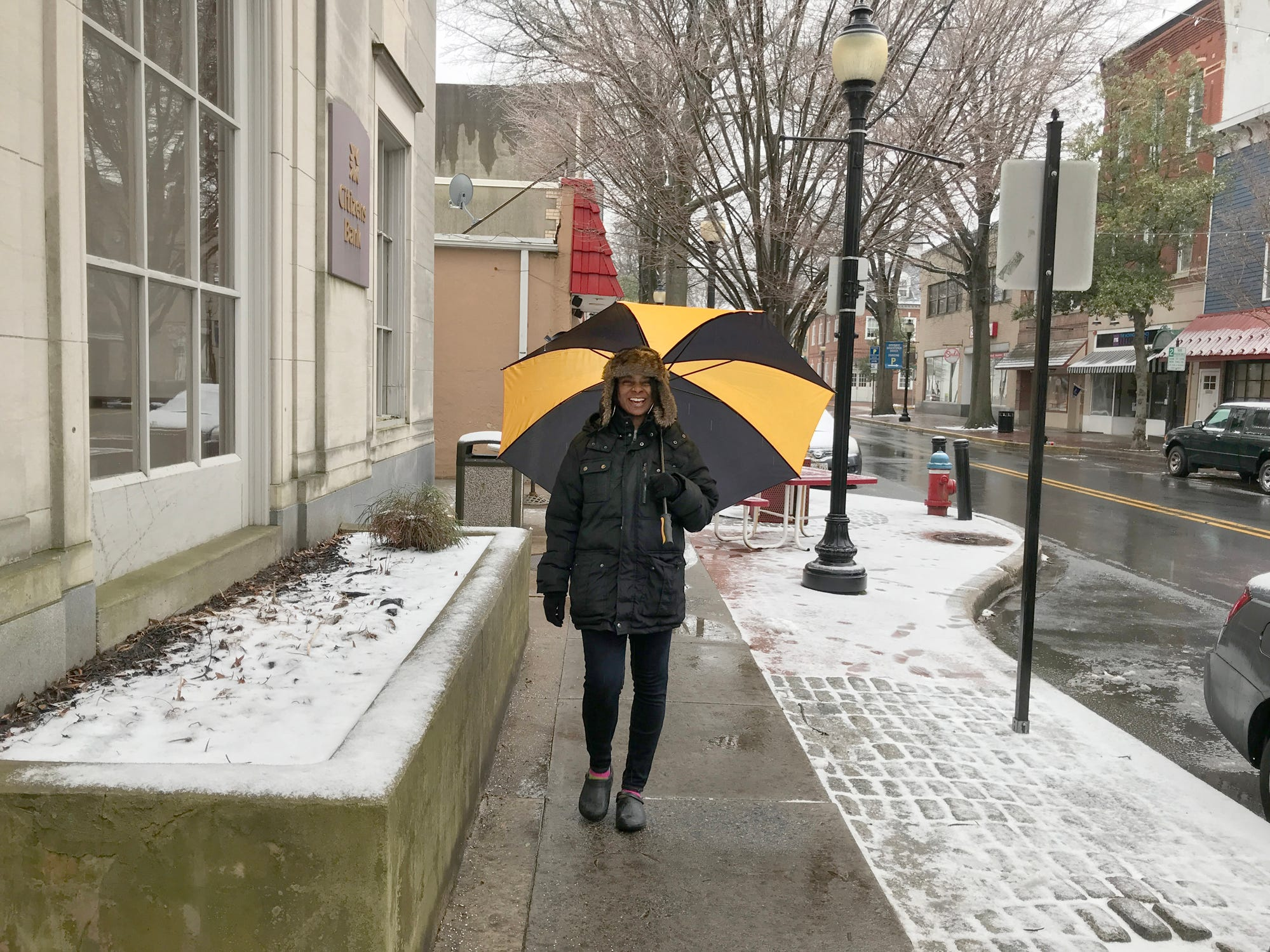 Cherry Seabrooks walks on Loockerman Street in downtown Dover on Monday morning. Seabrooks needed an umbrella as a wintery mix fell in Dover. She said the sidewalks were slippery in some spots but most of the snow and ice had already melted.