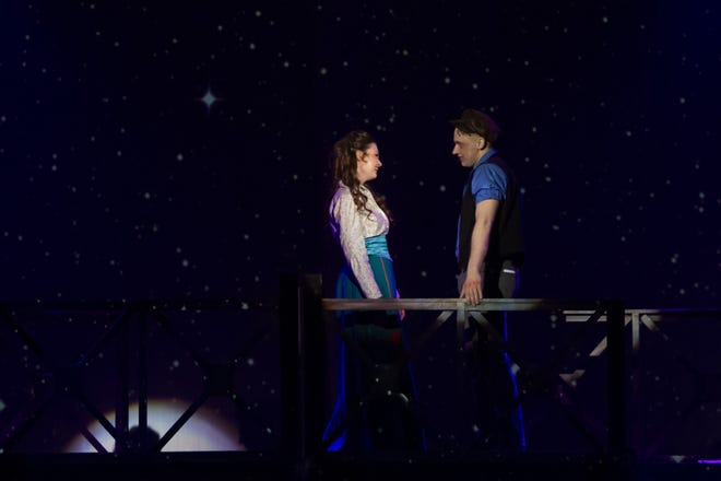 """Katherine (Amanda Jackson) and Jack (Bryson Petersen) realize that even though their pasts are far different, their goals may put their futures on the same path, in The Wichita Theatre's latest production, """"Disney's Newsies The Broadway Musical."""""""