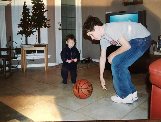 Tyler Owen (right) with his baby brother Max about 15 years ago. Tyler is now Windthorst's head basketball coach and Max is the starting point guard.
