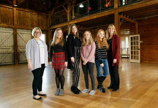 Westerville schools gifted coordinator Caley Nestor Baker, Westerville Central juniors Rachel Kaufman, Anna Borders, Sarah Gellner, Wellington junior Adriane Thompson and Genoa Middle School gifted facilitator stand inside the Everal Barn & Homestead in Westerville, Ohio.