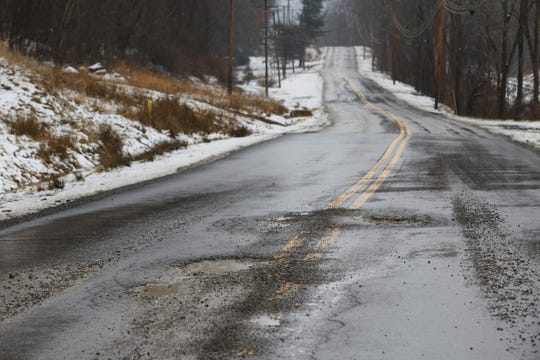 The fluctuating winter temperatures have produced the typical crop of potholes, including this set on North River Road West.